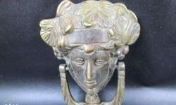 Antique door knocker. Roman goddess of wisdom and