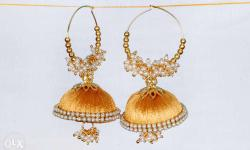 One pair of medium size golden colour with pearls