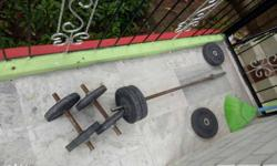 Rusted Brown Metal Barbell Rod With Weight Plates