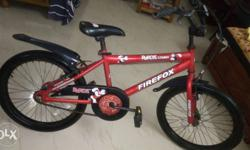 Red Firefox BMX Bicycle. 4 year old. Not used at all.