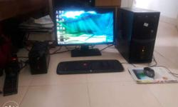 Flat Screen Computer Monitor, Black Corded Keyboard And
