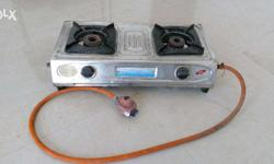 It's 2 burner Surya Brand Gas stove. Needs to be