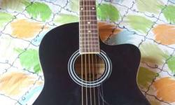 Gb acoustic guitar(branded) ,jet black colour. Made of