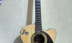 �Givson Guitar (Jumbo Size). �Price negotiable.