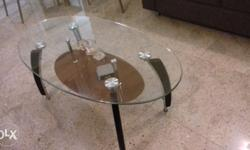 Glass center table with storage..in very good condition