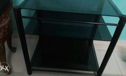 Glass TV trolley. In good condition.