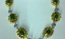 This necklace set is gold plated and hand-made and