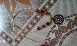 Gold, Red, And Black Beaded Pendant Necklace