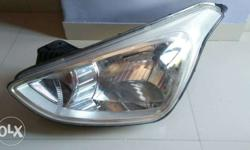 Grand i10 Left Side Headlight company Condition very