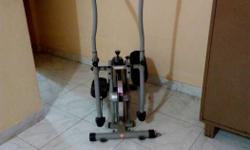 Gray And Black Elliptical Machine