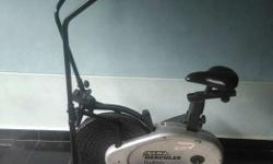 Gray And Black Hercules Elliptical Trainer