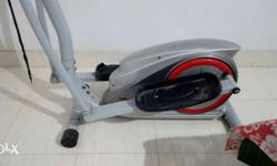 Gray Black And Red Elliptical Machine