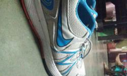 Grey And Blue Nike Running Shoe