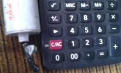 Grey Casio Desktop Calculator And White Capacitor