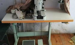 Grey Juki Overlock Sewing Machine With Brown Wooden
