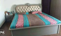 Grey Wooden Bed Frame, Blue, Grey, And Pink Bed Cover