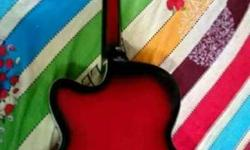 guitar its fender company guitar . red nd black colour