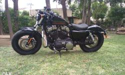 Hi, I am selling Harley 48 2015 just done 1100 Kms. It