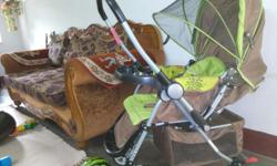 Very good condition baby stroller along with rocker for