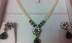 This is Hyderabadi pearl set with emerald drops