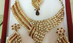 half side studded and half side kundan work with