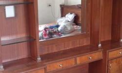 Its a dressing table with 4 draws ,2 side racks and 4