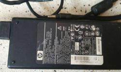 Black HP Powerbrick laptop charger