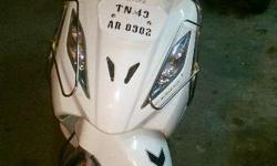 A brand tvs wego scooter. White colour a single person