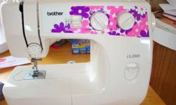 ls 2000 brother sewing machine with its accessories