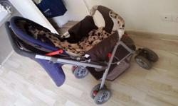 Luvlap pram / stroller with brakes and 360 movement,