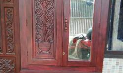Maroon Wooden Cabinet With Mirror