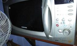 18 litre Samsung microwave oven, old however not used