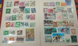 My stamp book full of indian and imported stamps for
