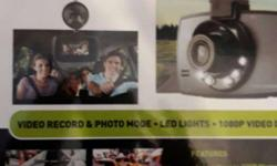 New and Unused car camera. records videos and clicks
