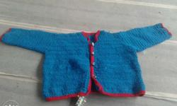 NEW HAND KNITTED SWEATER OF WOOL SIZE IS 33CMx37cm.