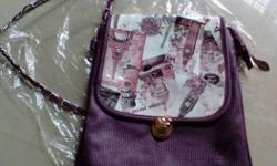 New stylish sling bag purple color with long chain.