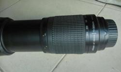 Single hand use one year old 70.300mm zoom lens nikon