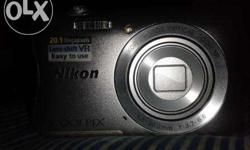 1 month old Nikon Coolpix S3700 (White) model with its