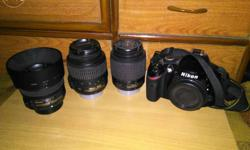 Nikon D3200 body with 18-55mm kit lens, 50mm 1.8g and