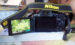 Its a Nikon dslr camera having 18-55mm lens with vr