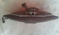 It is an antique submarine metal toy with motor inside