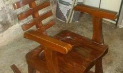 old Teakwood Rocking chair for sale its an antique