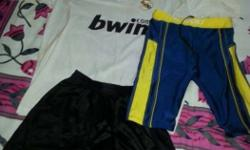 one real madrid football jersey along with one football