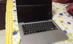 One week old Mac Book Pro. Not even used once. i5 5500