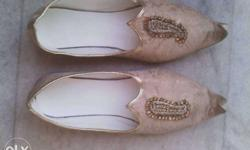 Pair Of Beige Leather Flats