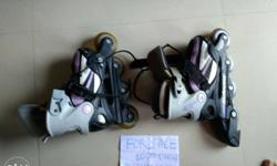 Pair Of Black-and-white In-line Skates