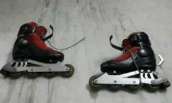 Pair Of Black And Red Inline Skates