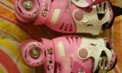 Pair Of Pink-and-white Roller Skates