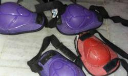 Pair Of Purple And Red Knee Pads