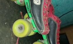 Pair Of Red-and-black Roller Skates